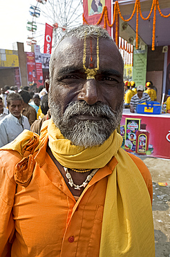 Bihari villager, a Vishnaivite devotee with tilak on his forehead indicating the Hindu god Vishnu, wearing orange clothing for visit to the Vishnu temple at Sonepur Cattle Fair, near Patna, Bihar, India, Asia