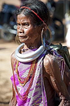 Mature Gadaba tribeswoman with traditional double silver necklaces denoting her tribe, at Bonda tribal street market, Rayagader, Orissa, India, Asia