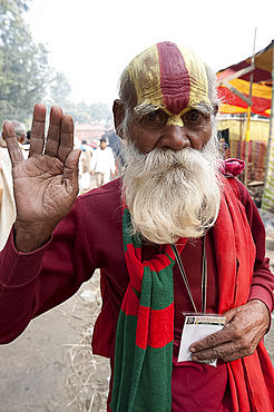 Vaishnavite pundit dressed in red and with heavy sandalwood and abir tilak on his forehead, at Sonepur Cattle Fair, Bihar, India, Asia