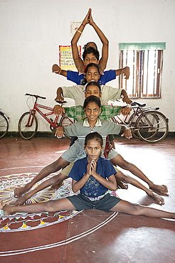 Young boys being trained as female Gotipua dancers performing in praise of Lord Jagannath and Lord Krishna, Raghurajpur, Orissa, India, Asia