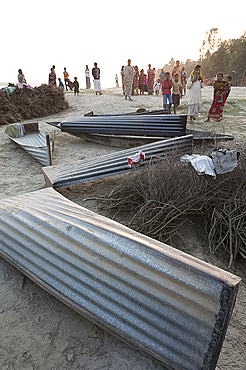 Small boats made from single sheets of corrugated iron, lying on the sandy banks of the River Hugli (River Hooghly), West Bengal, India, Asia