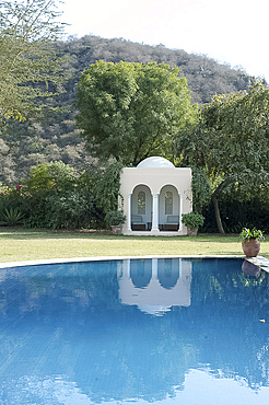 Arched Moghul folly in a quiet garden, Haryana, India, Asia