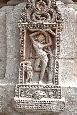 Erotic carving of woman on the 11th century Rajarani temple, known as the love temple, dedicated to Lord Shiva, Bhubaneshwar, Orissa, India, Asia