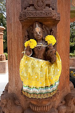 Carved temple detail dressed for festival with cloth and marigolds, Bhubaneshwar, Orissa, India, Asia