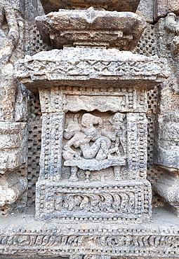 Erotic carving on the wall of the 13th century Konarak Sun temple, built as the chariot of Surya the Sun god, UNESCO World Heritage Site, Konarak, Orissa, India, Asia