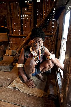Naga Konyak tribal headhunter with traditional tattooed face, deer horn earrings, animal teeth and beads, elephant tusk armbands, Ngangting, Nagaland, India, Asia