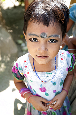 Young village girl of the Bodo tribe, with kohl make-up on eyes and eyebrows, and black dot to ward off evil spirits, Assam, India, Asia