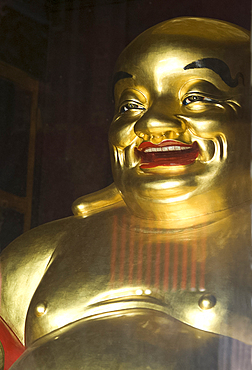 Large golden smiling Buddha in Kek Lok Si Buddhist temple, Air Itam, Georgetown, Penang, Malaysia, Southeast Asia, Asia
