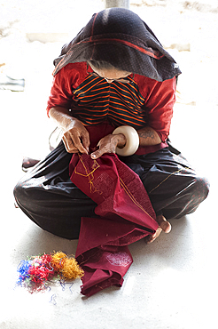 Aahir tribeswoman embroidering intricate traditional patterns in very fine chain stitch, Bhuj district, Gujarat, India, Asia