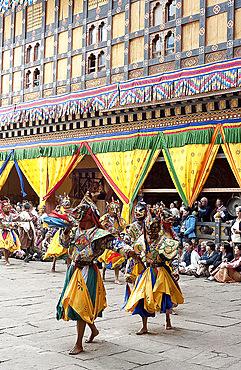 Monks in costume and animal masks performing ceremonial dance at Paro Tsechu (annual festival), Paro Dzong (monastery), Paro, Bhutan, Asia
