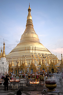 Candles placed by devotees at sunset in front of the golden Shwesagon Pagoda, a 2500 year old Buddhist pilgrimage site, Yangon, Myanmar (Burma), Asia