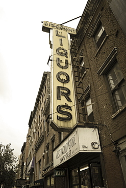 Old liquor store shop front and sign, Chelsea, Manhattan, New York City, New York, United States of America, North America