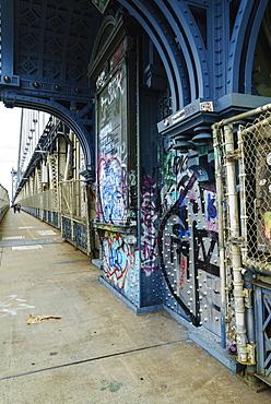 Pedestrian walkway and graffiti, Manhattan Bridge, New York City, New York, United States of America, North America