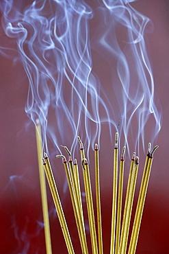 Incense sticks on joss stick pot burning, smoke used to pay respect to the Buddha, Vung Tau, Vietnam, Indochina, Southeast Asia, Asia