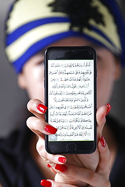 Woman with a digital Quran on a smartphone, Vietnam, Indochina, Southeast Asia, Asia