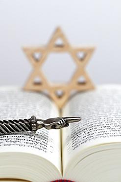 A silver Yad Jewish ritual pointer, a Jewish star (Star of David) and a Torah, Jewish symbols, France, Europe
