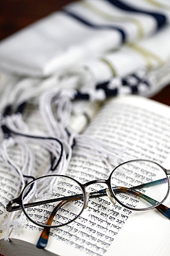 Open Torah, tallit and pair of glasses, France, Europe