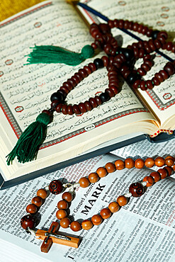 Bible, Quran, Crucifix and Prayer Beads, interfaith symbols of Christianity and Islam, the two largest religions in the world, Dubai, United Arab Emirates, Middle East