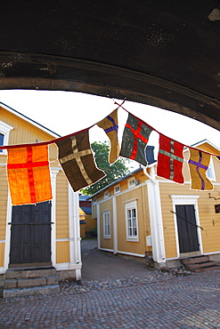 Decorative flags and medieval wooden houses, Porvoo, Uusimaa, Finland, Scandinavia, Europe
