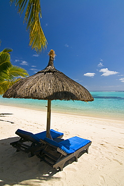 Sun lounger on the beach of the Beachcomber Le Paradis five star hotel, Mauritius, Indian Ocean, Africa
