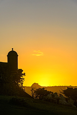 Backlit watchtower of the Fortress of Fortaleza San Felipe, Puerto Plata, Dominican Republic, West Indies, Caribbean, Central America