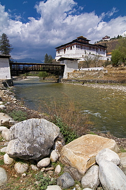 The Paro Tsong (a old castle) and a wooden covered bridge, Paro, Bhutan, Asia
