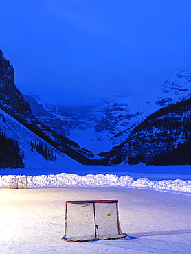 Ice rink with hockey nets on frozen Lake Louise at dawn, Banff National Park, Alberta, Canada, North America