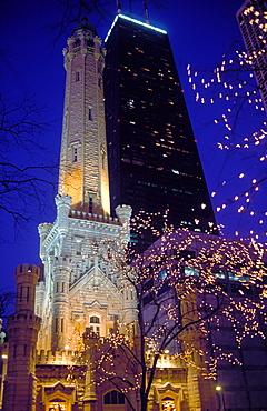Water Tower and the John Hancock Center illuminated at night at Christmas time, Chicago, Illinois, United States of America, North America