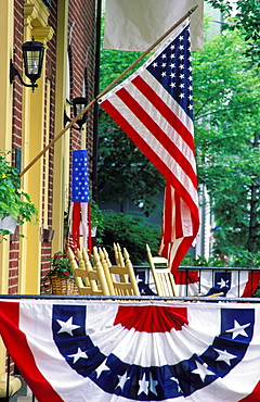 Flag displayed on porch with bunting, Chautauqua, New York, United States of America, North America
