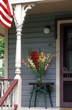 Vase of gladiolus on porch, Chautauqua, New York State, United States of America, North America