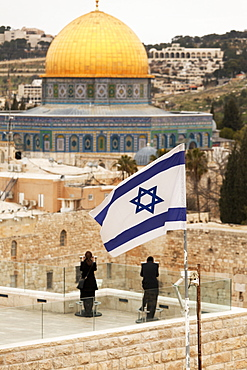 Couple looking over to the Dome of the Rock and the Wailing Wall at dusk, Jerusalem, Israel, Middle East