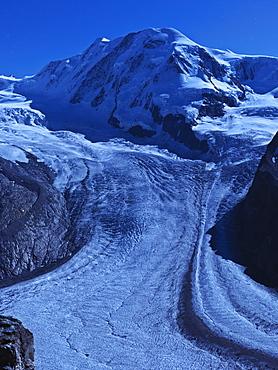 Mount Breithorn and the Gorner Glacier illuminated by moon light, Gornergrat, Zermatt, Valais, Switzerland, Europe