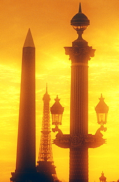Ornate lamp post and Egyptian Obelisk, Place de la Concorde, and Eiffel Tower in the background, Paris, France, Europe