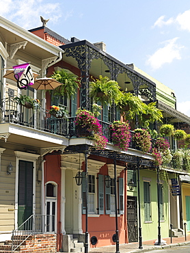 Colorful French Quarter residential street with wrought iron balconies and hanging flower baskets, New Orleans, Louisiana, United States of America, North America