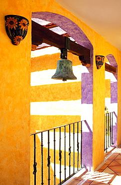 Colorful corridor in hotel with antique brass bell, Playa del Carmen, Yucatan, Mexico, North America - 818-549