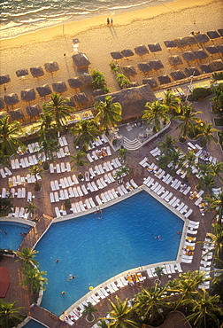 Aerial view of beach with pool and palapas on the beach, Acapulco, Mexico, North America