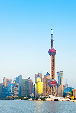 Skyline of Pudong Financial District including Oriental Pearl Tower, across Huangpu River, Shanghai, China, Asia