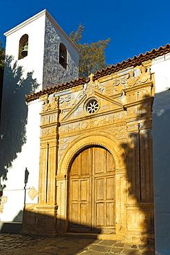 Bell tower and ornate doorway of the late 17th century Church of Nuestra Senora de la Regla, Pajara, Fuerteventura, Canary Islands, Spain, Atlantic, Europe