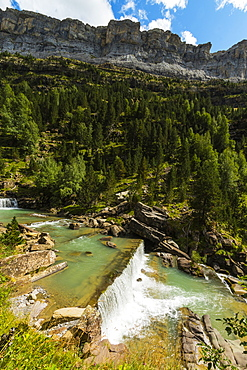Sierra de las Cutas on the south rim above a Rio Arazas waterfall, Ordesa Valley, Ordesa National Park, Pyrenees, Aragon, Spain, Europe