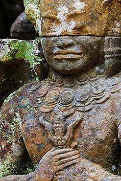 A carved dvarapala entrance guardian stone at the 12th century Preah Khan (Prah Khan) Buddhist temple complex, Angkor, UNESCO World Heritage Site, Siem Reap, Cambodia, Indochina, Southeast Asia, Asia