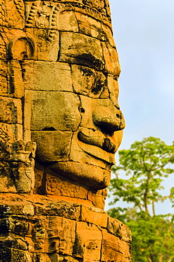 One of 216 smiling sandstone faces at 12th century Bayon, King Jayavarman VII's last temple in Angkor Thom, Angkor, UNESCO World Heritage Site, Siem Reap, Cambodia, Indochina, Southeast Asia, Asia