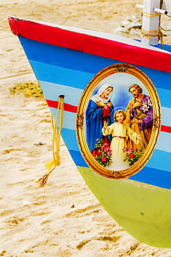 Colourful prow of fishing boat with Jesus, Mary, Joseph Christian picture on Marari Beach, Mararikulam, Alappuzha, Kerala, India, Asia