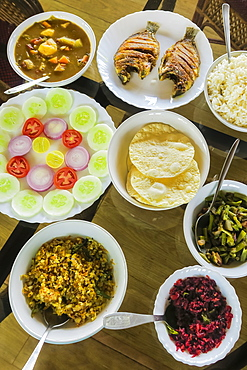 Typical Keralan meal on backwater houseboat, rice, beans, cabbage, curry, papad, fried fish, Alappuzha (Alleppey), Kerala, India, Asia