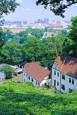 Houses amid trees and city skyline in the background, of Birmingham, a former premier steel producer and Civil Rights centre, Alabama, USA