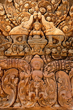 Stone relief god Indra with elephants temple Banteay Srei Angkor Siem Reap Cambodia