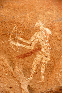 Neolithic rock drawing of a hunting man with weapons bow and arrow Acacus Libya