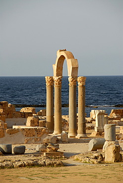 Pillars and arch at sea Sabratha Libya