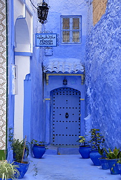 Luminous blue gate of Pension Cordoba medina Chefchaouen Morocco