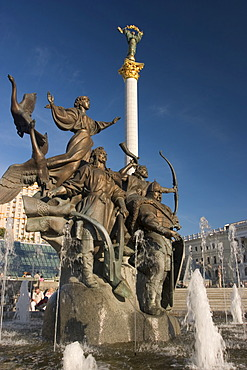 Ukraine Kiev Place of Independence memorial of the founder of the city of Kiev sovereigns Kyj, Scek, Chryv and their sister Lybid´ memorial in bronze shining water fountain blue sky historical memorial column of Independence 2004