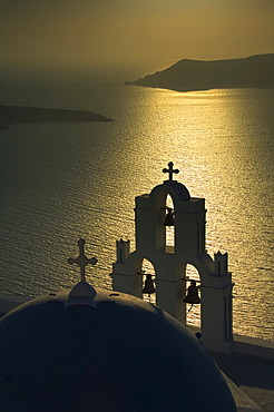Bell tower and dome of a church at sunset, Firostefani, Santorini, Cyclades, Aegean Sea, Greece